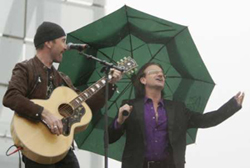 Bono and The Edge, performing at Clinton Presidential Library dedication ceremony
